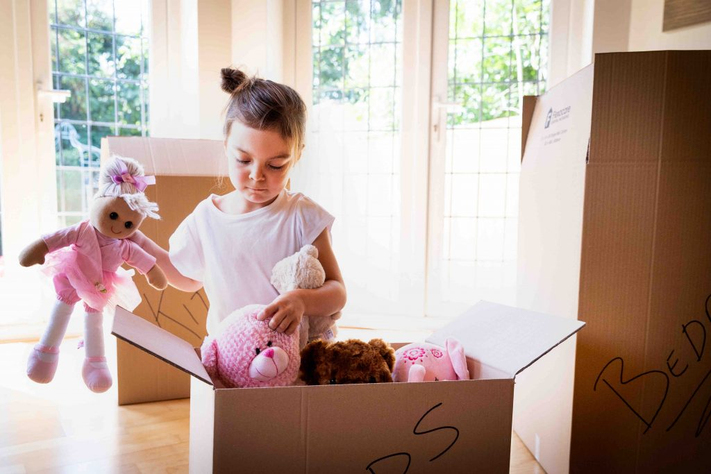a young girl packing